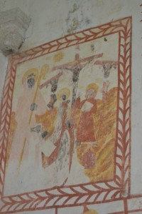 Crucifixion: le personnage agenouillé est probablement le donateur dont le patron est Saint Hubert évêque de Liège